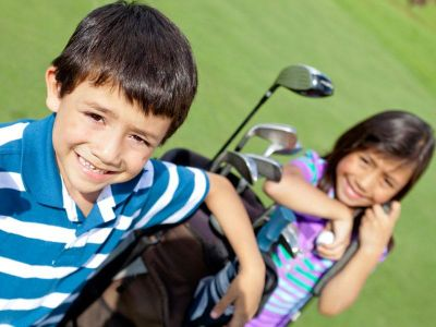 Children with golf clubs